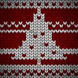 Tessuto tricottato rosso con un albero bianco di abete e dell'ornamento illustrazione vettoriale