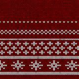 Tessuto tricottato rosso con un ornamento bianco con gli snowflackes illustrazione vettoriale