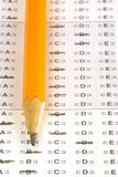 Test. A pencil sitting on a test paper filled out Royalty Free Stock Image