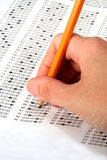 Test. Hand holding pencil filling out an answer sheet Stock Image