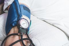 Test with a blood pressure meter. The man has the blood pressure tested. High score, hypertension. Health problems, heart problems. Holesterol. Medicine and stock photo