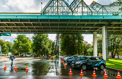 Test-drive in Moscow Gorky park. Cars under Andreevsky pedestria Royalty Free Stock Images
