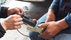 Test electric current and Repair Car lock Royalty Free Stock Image