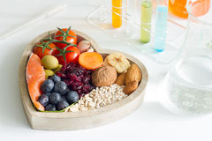 Test food ingredients in laboratory concept with healthy food in heart Stock Photos