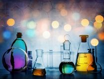 Test glass flask with solution in research laboratory. Science a stock photos