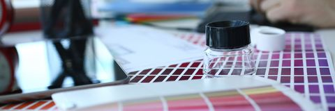 Test print paper page with colour test design fantail and magnifying glass. Lying at worktable for further promotion closeup royalty free stock photos
