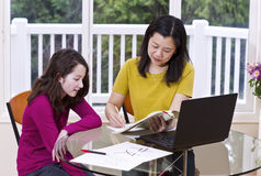 Test Results Reviewed by Asian Teacher Royalty Free Stock Photography