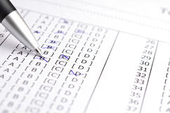 Test score. Pen on Test score sheet with answers stock photo
