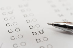 Test score sheet with answers and ballpoint Stock Photography