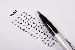 Test score sheet with answers and pen Royalty Free Stock Photos