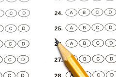 Test score sheet with answers and pencil.  Stock Photo