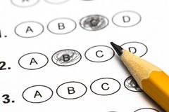 Test score sheet with answers and pencil . Closeup.  Royalty Free Stock Image