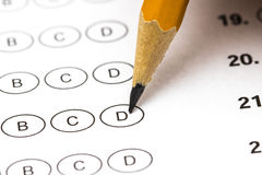 Test score sheet with answers and pencil . Closeup.  Stock Photos