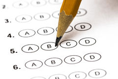 Test score sheet with answers and pencil . Closeup.  Stock Images