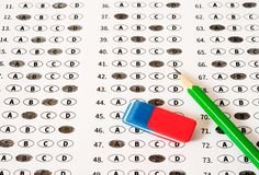 Test score sheet with answers. School and education concept. Test answer sheet with pencil. Examination test. Education concept Royalty Free Stock Photos
