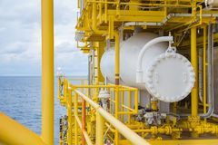 Test separator at offshore oil and gas wellhead remote platform for collect value of gas, condensate and water. Test separator at oil and gas wellhead remote stock photos
