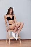 Test shots young brunette model posing sitting on ladder against wall for modeling agency snapshots portfolio Royalty Free Stock Photo