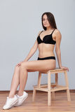 Test shots young brunette model posing sitting on ladder against wall for modeling agency snapshots portfolio Stock Photos