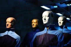 Test team. Four crash test dummies dressed in blue Stock Photos