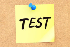 Test. Text on a sticky note pinned to a corkboard. 3D rendering Royalty Free Stock Images