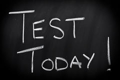 Test today. Written on blackboard with chalk royalty free stock image
