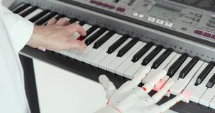 Test trials of robotic prosthesis hand playing the piano trying to press the right keys repeating for human hand.