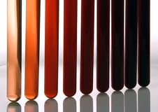 Test tube. With various red sample in white background Stock Photography