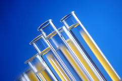 Test tube. Close up test tube with blue background stock images