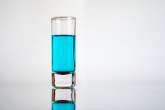 Test tube with blue liquid. With a reflection Royalty Free Stock Photography