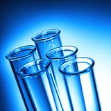 Test Tube Close up. Row of Test Tubes in Blue Tone - Medical Background Royalty Free Stock Images