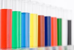 Test tube colored on white background Stock Images