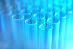 Test Tube DNA Cloning. Several DNA being withdrawn from the test tubes. Concept image of genetic cloning royalty free stock photos