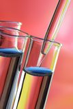Test tube and dropper. A scientific test tube and dropper on a colorful background Royalty Free Stock Photo