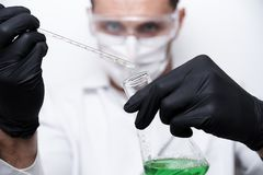A test tube with a falling drop in a glass flask royalty free stock photos