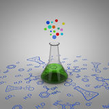 Test tube with green liquid and bubbles Stock Photo