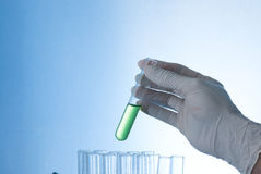 Test tube in hand Stock Photos