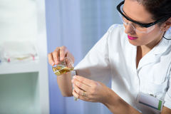 Test tube with urine sample in doctor hand. Test tube with urine sample in woman doctor hand Royalty Free Stock Image