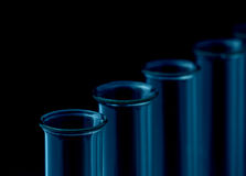 Test tubes. Glass test tubes against a black background, selective focus Stock Images