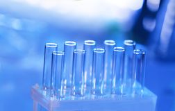 Test tubes on background. Test tubes on blurred background Royalty Free Stock Photos