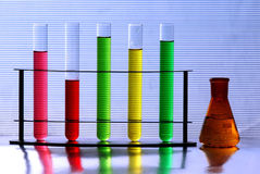 Test tubes and beaker. Beaker and test tubes with colorful chemical royalty free stock photography
