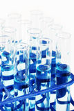 Test tubes with blue liquid Stock Images