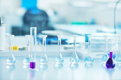 Test tubes in bright modern labaratory royalty free stock photo