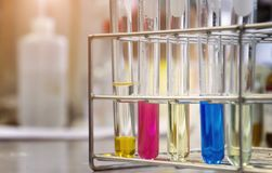 Test tubes with chemical reagents in chemical laboratory. scientist is doing experimentation royalty free stock photography