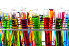 Test tubes. Closeup of a pile of test tubes with liquids of different colors royalty free stock photos