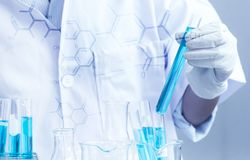 Scientist research chemistry at science lab. Test tubes closeup, science laboratory research and development concept Stock Image