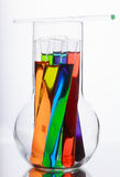 Test tubes with colored liquid in a glass flask on a white backg Royalty Free Stock Photos