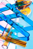 Test tubes with colored liquid (yellow and blue) on light pink a Royalty Free Stock Photos