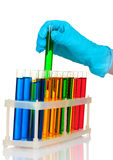 Test tubes with colorful liquids and hand Stock Photo