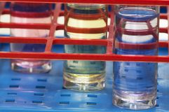 Test tubes with different chemicals Stock Photography