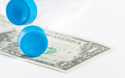 Test tubes on dollar, cost of medical health care Stock Photo